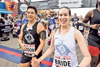 Couple runs race on wedding day with dozens of their guests