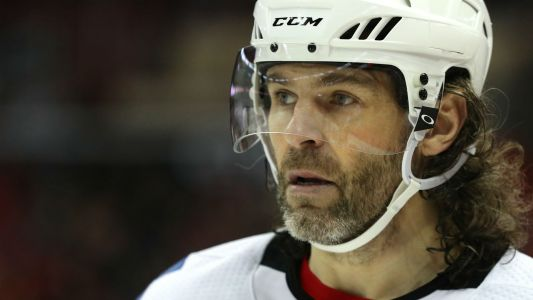 Jaromir Jagr takes scary hit to head in Czech Republic, helped off the ice