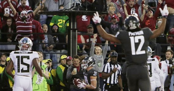 Washington State continues to baffle the Ducks, scoring key 34-20 victory