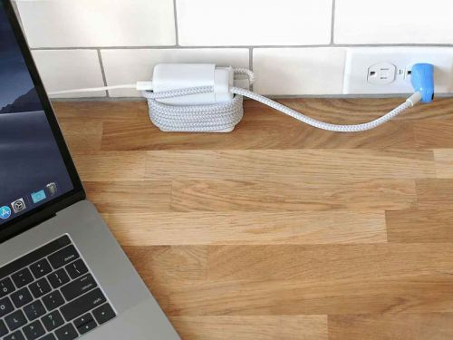 This illuminated laptop cord will help you stop fumbling for outlets