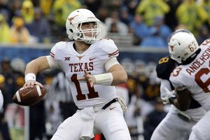 Ehlinger leads Texas over No. 24 WVU 28-14; Grier injured