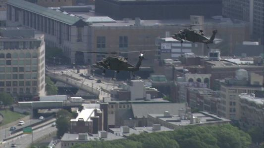 Black Hawk helicopters fly over Boston Marathon route