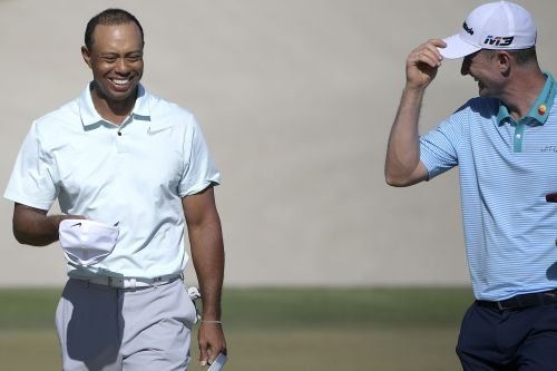 It was Tiger Woods' partner who made the big move