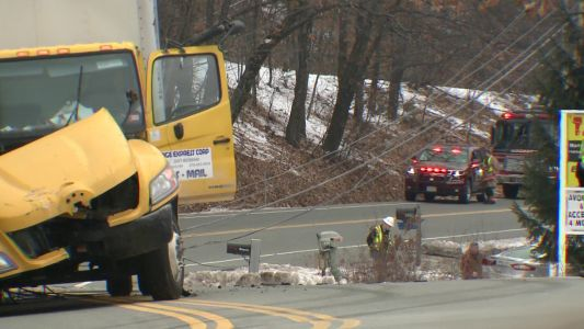 Raw video: Mail truck crashes in Hooksett, downing wires