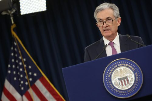 Fed keeps rates steady but opens door for cut