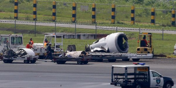 A Chinese plane that crash-landed in the Philippines lost an engine and a wheel before skidding to a halt