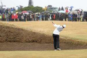 McIlroy reins it in at British Open, stays in mix with 69