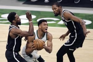 Bucks rally in 4th to beat Nets 124-118, clinch playoff spot