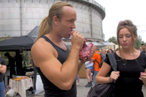 Man protests vegan food festival by eating raw, bloody veal heart