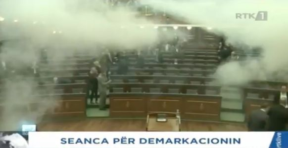 Kosovo's parliament was evacuated after a tear gas attack by opposition MPs
