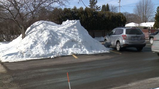 Large piles of snow left in parking lots hurts businesses