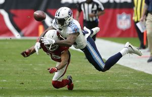 Cardinals beat Titans on Dawson's 4 field goals