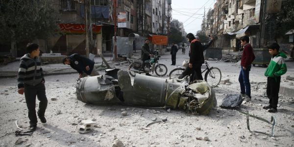 This photo shows how the horrors of war have become part of everyday life in Syria