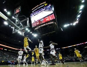 The Latest: USC routs Missouri State in Hall of Fame Classic