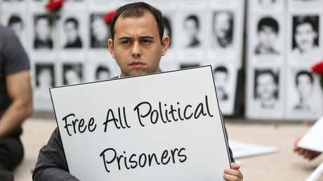 Iran releases 'political prisoners' amid Covid-19 outbreak, while virus-stricken UK keeps Assange behind bars