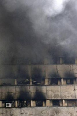 At least 30 firefighters killed after high-rise building engulfed in flames collapses in Iran
