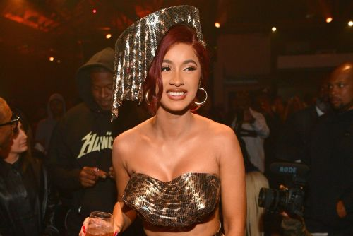 Cardi B wears dozens of watches and nothing else to promote 'Money'