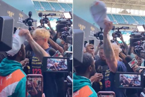 Jake Paul steals Floyd Mayweather's hat at pre-fight event, sparking wild brawl