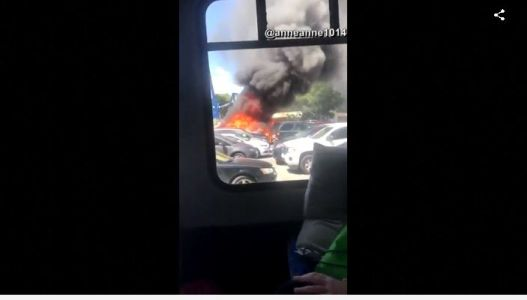 Caught on camera: Fire burns nearly a dozen cars in North Carolina parking lot