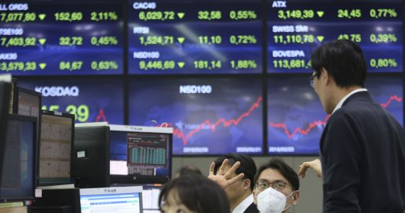 Asian shares take hit as new virus cases jump outside China