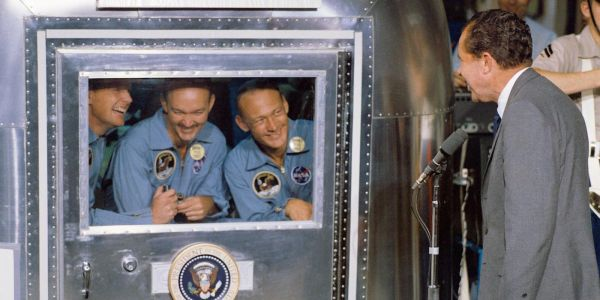 Bizarre photos show the Apollo 11 astronauts quarantined after returning from the moon as NASA worried they could infect Earth with space germs