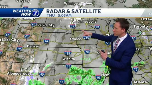 Cloudy, windy, and cooler Thursday with a sprinkle or flurry possible