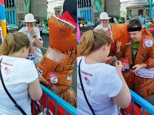 Watch this woman explode with joy when a man dressed in a dinosaur outfit proposes to her