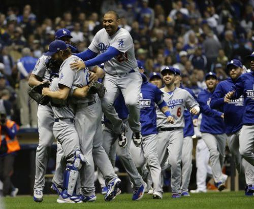 Los Angeles Dodgers advance to face Boston Red Sox in World Series, beating Milwaukee 5-1 in Game 7 for 23rd NL pennant