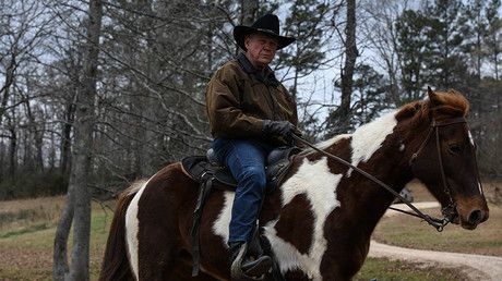 Alabama senate GOP nominee Roy Moore rides in on horseback to vote