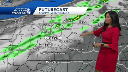 Mostly cloudy with isolated showers on Wednesday