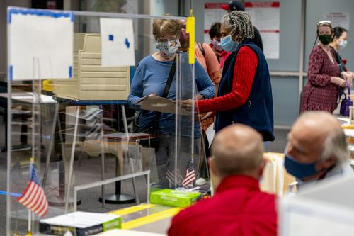 Trump calls for poll watchers. Election officials call for calm