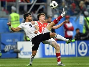 AP PHOTOS: More upsets on World Cup Day 6