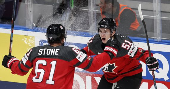 Canada, Finland advance to world hockey title game