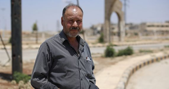 Under Assad's grip, uneasy co-existence with former rebels