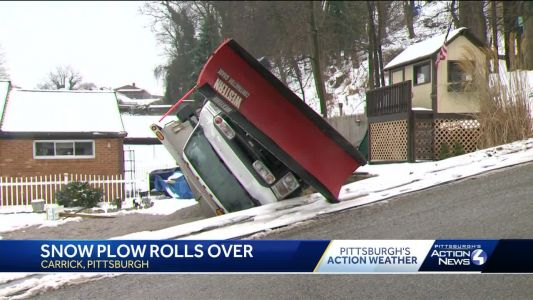 Plow truck driver taken to hospital after truck flips over