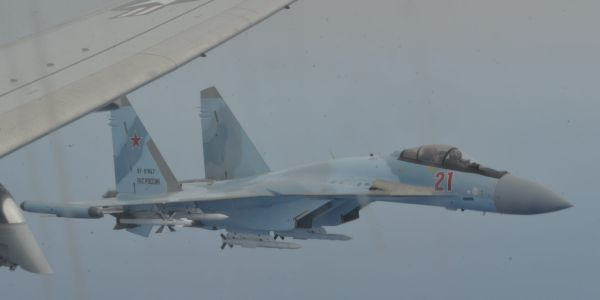 PHOTOS: The US Navy says a pair of Russian fighter jets 'unsafely' buzzed a US patrol aircraft, risking a midair collision