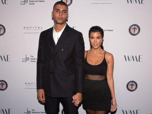 Kourtney Kardashian's boyfriend reportedly wants her to post more 'covered up pictures' - even though he shares similar photos