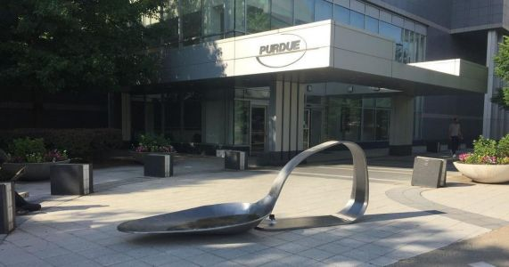 Drug spoon sculpture placed outside drug maker headquarters