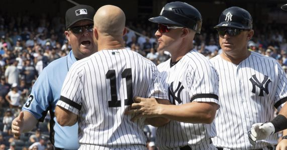 Boone, Gardner, Yanks hammer umps in 6-5 win over Indians
