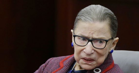 Ginsburg, 85, improving after fall but misses court session