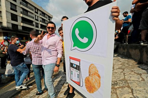 Protesters storm Lebanon after government proposes WhatsApp tax