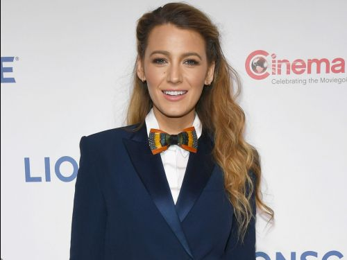 Blake Lively wore 2 velvet blazers with no shirt underneath in nearly 90-degree weather