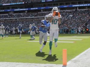 Johnson's 158 yards rushing help Lions beat Dolphins 32-21