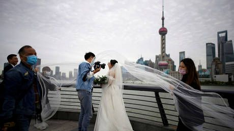 Wuhan couples BOMBARD marriage application app as coronavirus lockdown is lifted
