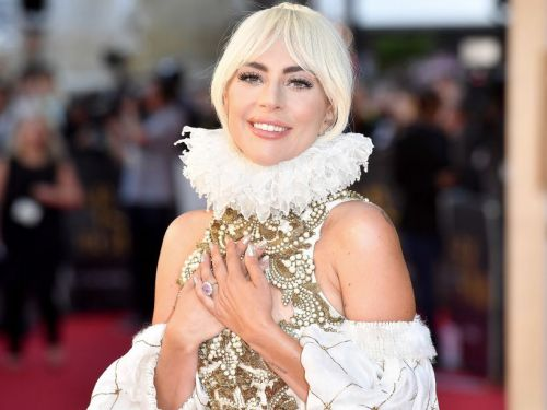 Lady Gaga's pink engagement ring is estimated to be worth $300,000 - and it looks a lot like the ones Princess Eugenie and Kate Middleton wear