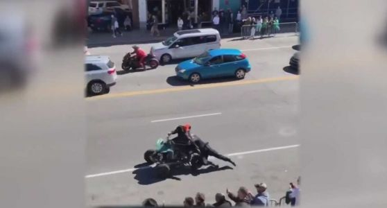 Watch: Officer dragged by ATV as 100 drivers illegally take over street