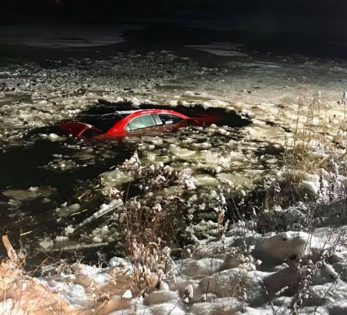 Man rescued from car sinking into Massachusetts pond