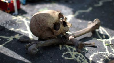 Grave robbers dig up skeletons, scatter bones around Manchester cemetery