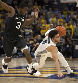 Howard and John lead Marquette to 79-69 win over Butler