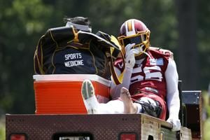 Redskins' Foster carted off field with apparent knee injury